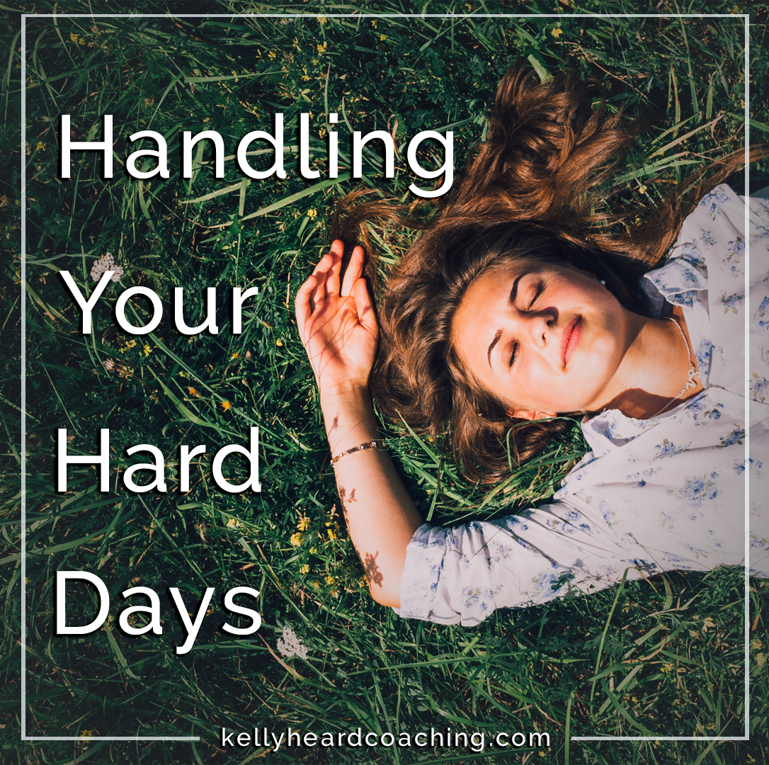 woman lying in grass Handling Your Hard Days Kelly Heard Coaching